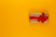 canvas print picture Christmas, holiday present box on red background.