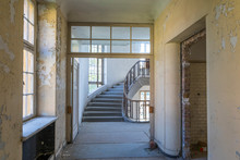 """Corridor To   Stairwell Of Former Historical Headquarters Barracks, """"Haus Der Offiziere"""", Abandoned By The Russian Army In 1994, Wünsdorf, Germany"""