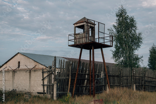 Slika na platnu Old observation tower in abandoned Soviet Russian prison complex