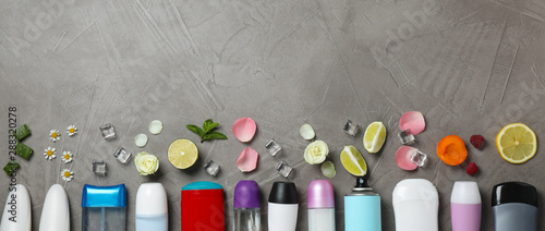 Photo Flat lay composition with different natural deodorants and space for text on gre