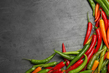 Different Ripe Chili Peppers Grey Table, Flat Lay. Space For Text