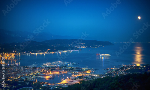 Photographie  Illuminated cruise ship in La Spezia Gulf at dusk