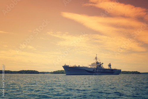Grey modern warship sailing in still water, marine military boat on the sea Canvas Print