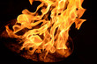 Fire flame on a black background. Burning passion, phenomenon of combustion manifested in light, flame and heat. To set on fire. Internal flame.