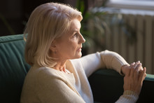 Pensive Elderly Woman Look In Distance Thinking Or Mourning