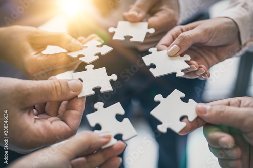Fototapety, obrazy: A group of business people assembling jigsaw puzzle.