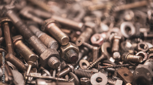 Fotomural  Pile of bolts, nuts and screws close-up