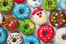 Set Of Christmas Donuts On Gra...