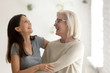 Leinwanddruck Bild Happy aged mother and millennial daughter have fun laughing