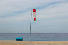 Windsock On The Seashore, Small House, Yellow Sand, Blue Sky