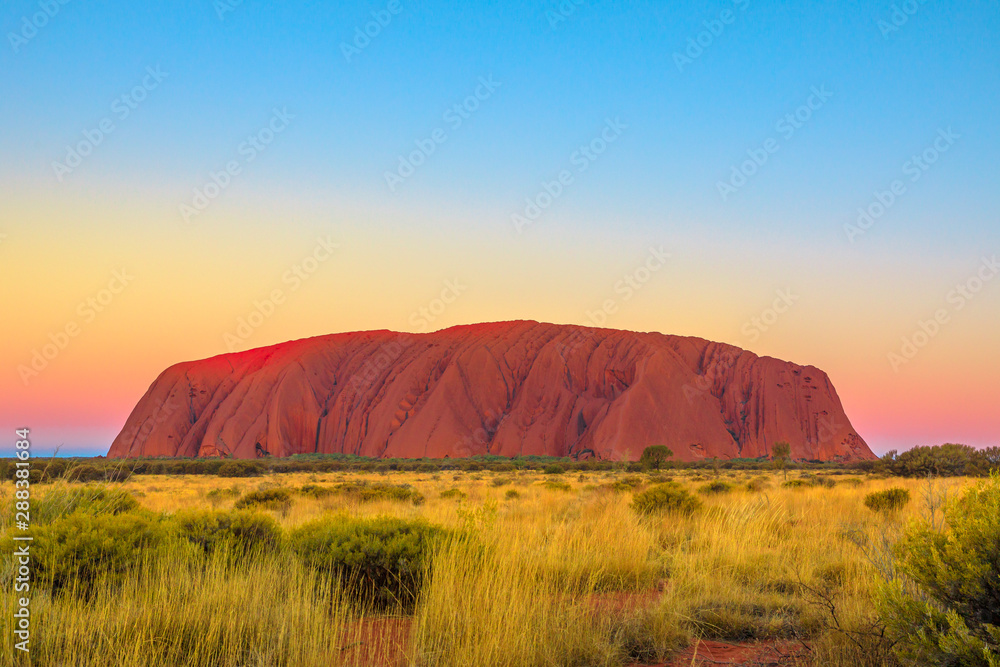 Fototapety, obrazy: Uluru or Ayers Rock after sunset. L'iconico monolith at twilight in Uluru-Kata Tjuta National Park, Australia, Northern Territory. Aboriginal land in Australian outback or Red Centre.