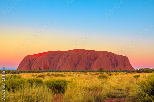 Foto auf Leinwand Blau Uluru or Ayers Rock after sunset. L'iconico monolith at twilight in Uluru-Kata Tjuta National Park, Australia, Northern Territory. Aboriginal land in Australian outback or Red Centre.