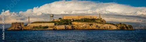 Wall Murals Paris Panorama of Alcatraz Island with grand white clouds behind the old buildings on the hard rock