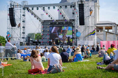 Couple is watching concert at open air music festival - 288392859