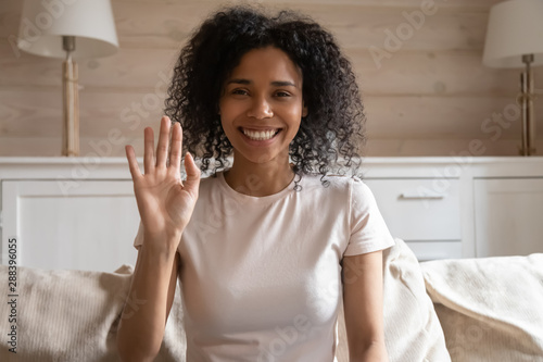 Happy biracial woman wave talking on video call Fototapet