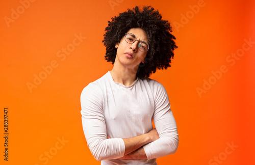 canvas print motiv - Prostock-studio : Skeptical black millennial man, looking suspiciously at camera