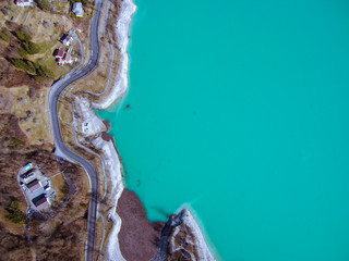 Aerial zenital view of amazing colorful Barcis green lake in Friuli Venezia Giulia. Nature trekking destinations and Mountain tourism icon