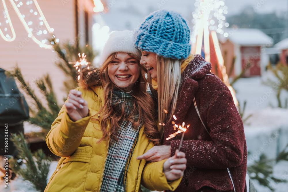 Fototapety, obrazy: Joyful best friends having fun on Christmas market