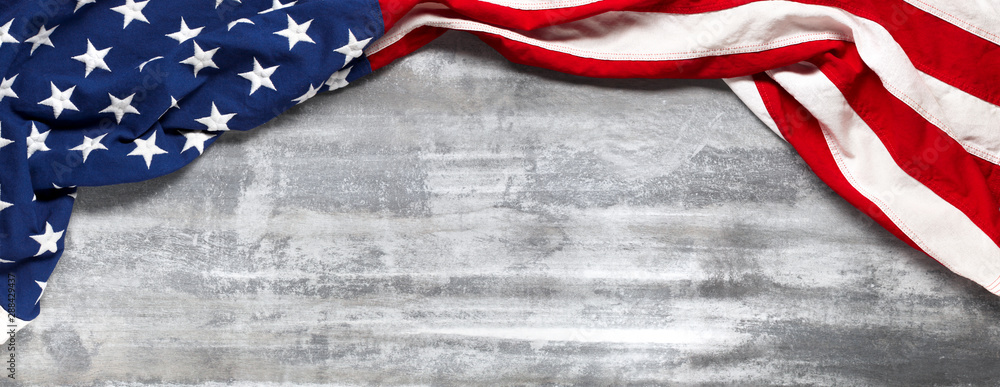 Fototapeta US American flag on worn white wooden background. For USA Memorial day, Veteran's day, Labor day, or 4th of July celebration. With blank space for text.