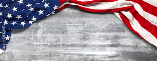Fotografia US American flag on worn white wooden background