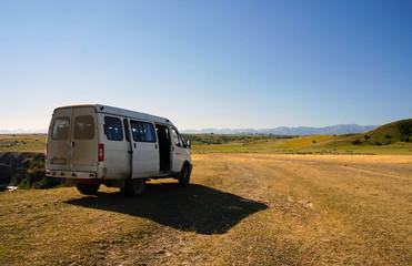 A white van on the plains of southern Kazakhstan near Aksu Canyon