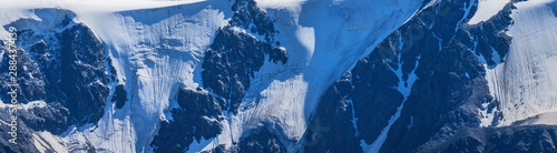 Natural background, banner. Glaciers and snow on the hillside. Canvas Print