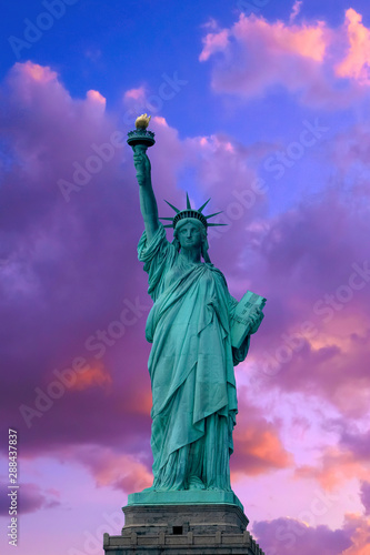 Close up of the Statue of Liberty on clouds sky, New York City Wall mural
