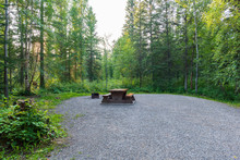Empty Campsite With Picnic Table In Liard River Hot Springs Provincial Park, British Columbia, Canada