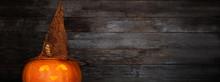 Halloween Pumpkin On Old Woode...