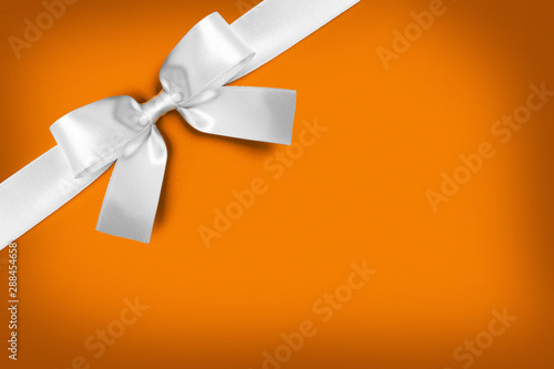 canvas print motiv - yellowj : White gift bow on orange
