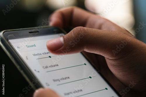 attractive hands playing sound tools on a smart phone Wallpaper Mural