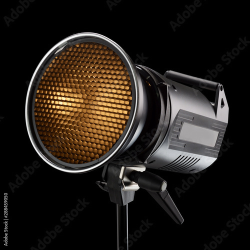 Obraz Photography studio flash with honeycomb on black background - fototapety do salonu