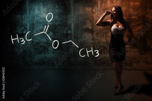 Obraz na plátne  Sexy girl or secretary or female student presenting handdrawn chemical formula o