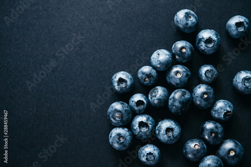Useful and tasty blueberries on a dark background. Berry or fruit background. - 288459467