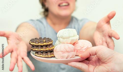 Keuken foto achterwand Kruidenierswinkel Obesity. Obese woman eating sweets. Woman loves sweet. Diabetes. Health problems obesity.