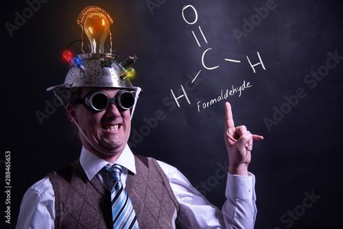 Photo Nerd presenting handdrawn chemical formula of Formaldehyde