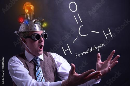 Nerd presenting handdrawn chemical formula of Formaldehyde Wallpaper Mural