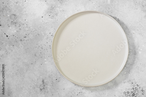 A white plate on a light gray table