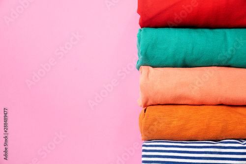 close up of rolled colorful clothes on pink background, preparing for travel Canvas-taulu