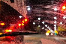 Windshield Wipers From Inside Of Car, Season Rain, Front And Background Blurred With Bokeh Effect