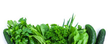 Fresh Green Vegetables And Herbs Border On White Background