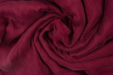Soft Smooth Burgundy Silk Fabric Background. Fabric Texture.