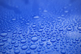 Closeup blue car paint surface with hydrophobic ceramic coating