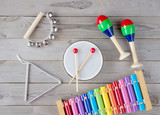 music accessories for children on wooden background. top view.