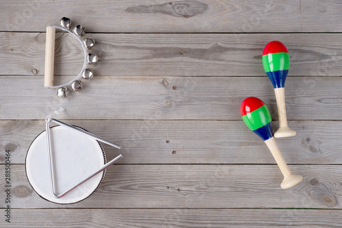 Photo music accessories for children on wooden background. top view.