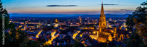 Fotobehang Panoramafoto s Germany, XXL panorama of city freiburg im breisgau from above in summer in magical twilight atmosphere after sunset