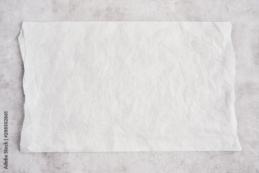 Fototapety, obrazy: Crumpled piece of white parchment or baking paper on grey concrete background. Top view. Copy space for text and design element.