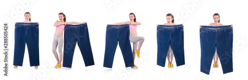 Woman with oversized jeans in dieting concept Wallpaper Mural