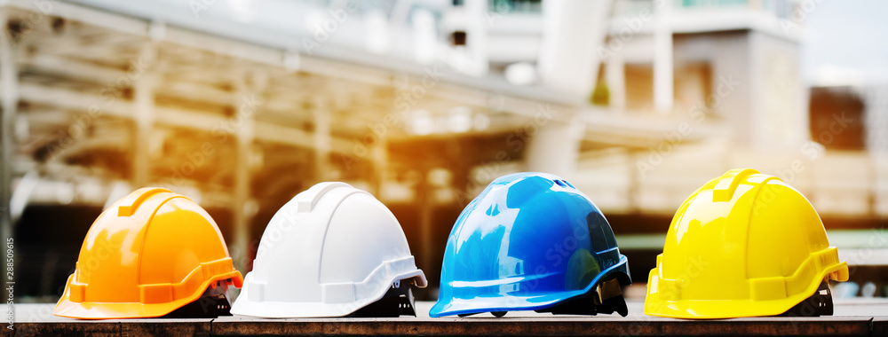 Fototapety, obrazy: Quality contractor teamwork. Safety construction for engineer or building work site or plant. Wearing helmet and protective equipment can safe worker life in industrial work or plant. copy space