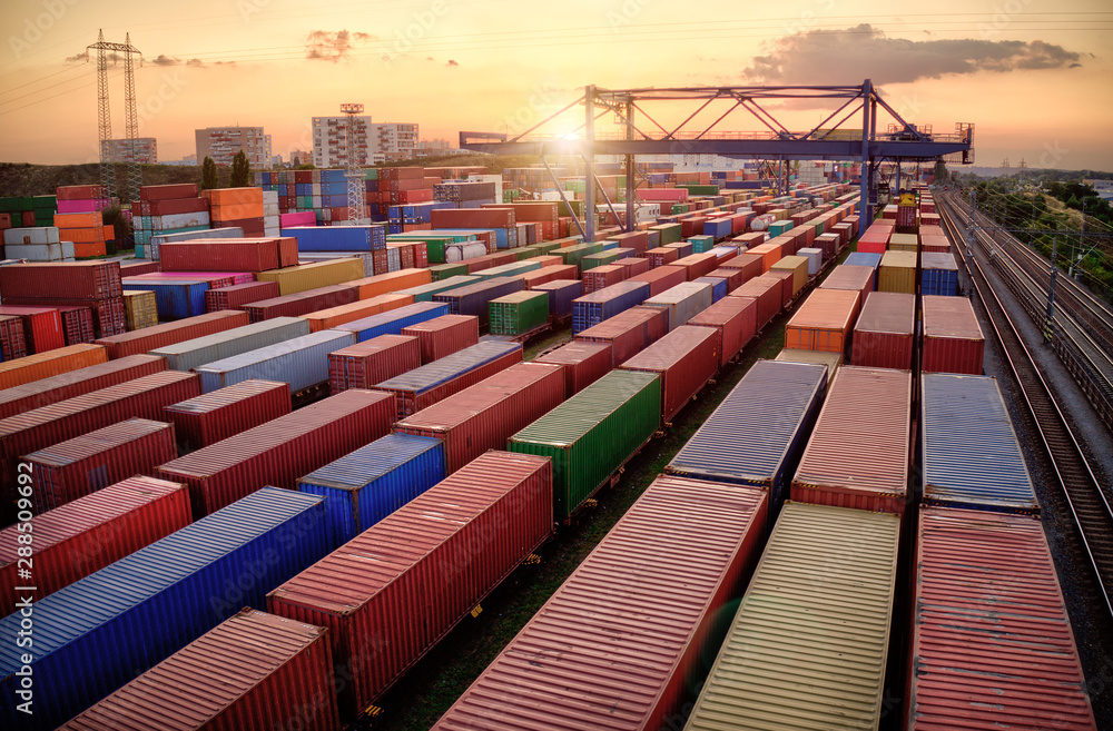 Fototapeta Container vagoons in export and import business and logistics. Aerial view